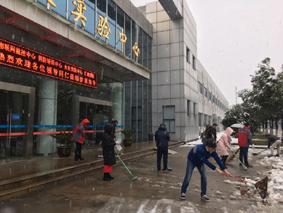 天寒雪飘,情暖南消 ——中国南消扫雪报道