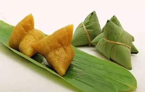 """粽子,最早叫做""""角黍"""",箬竹叶包裹黍成牛角状,煮熟而食."""