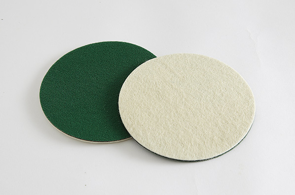 Hard needle polishing pad
