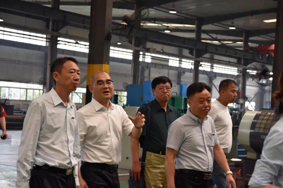 热烈欢迎南京轮挖协会考察团走进勤牛参观交流