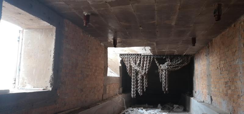"""回转窑窑尾烟室侧墙掉砖""""背包""""的原因及处理"""