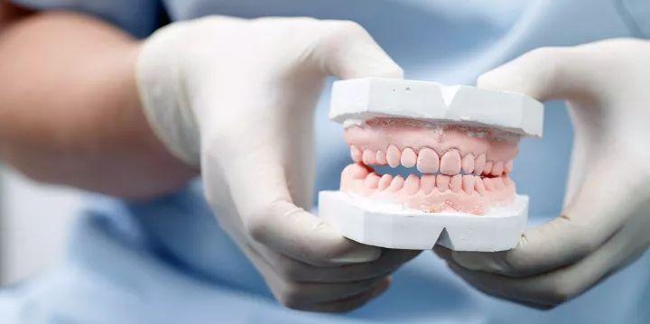 牙齿松动原因
