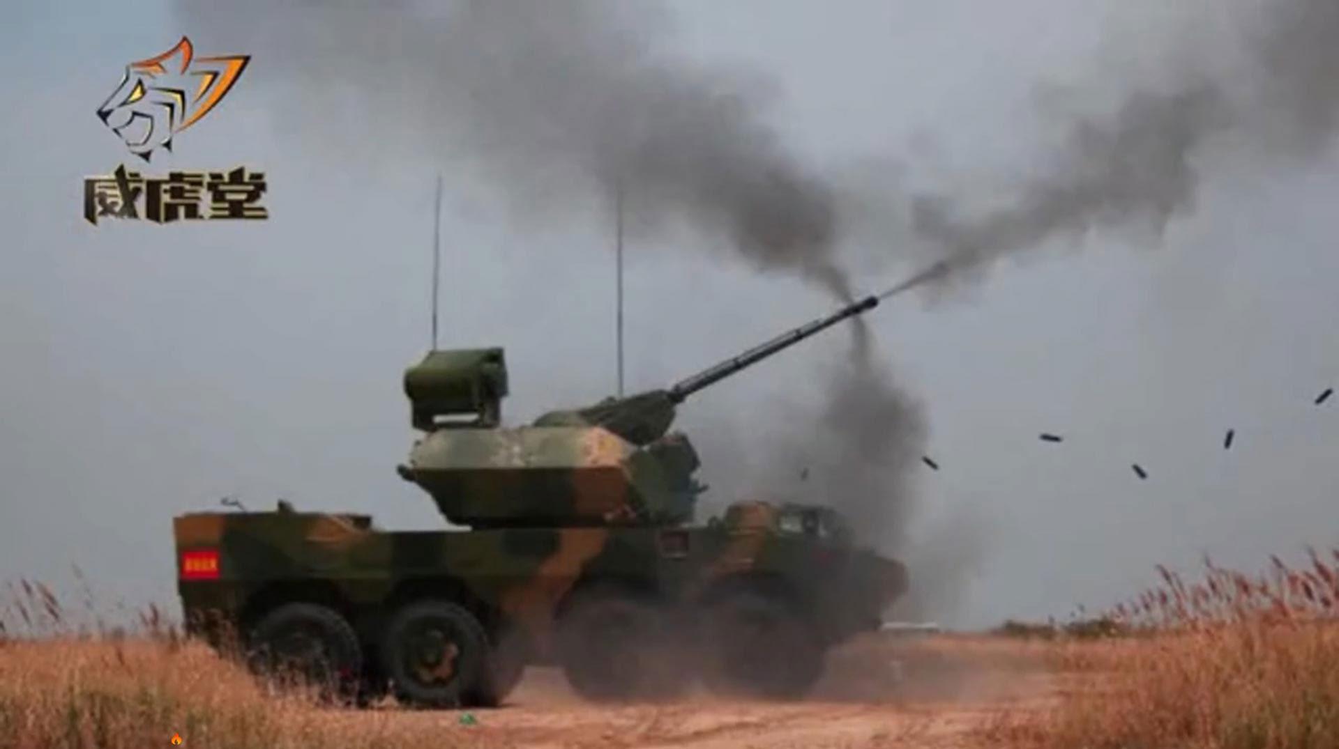 解放军披露新型自行高炮 采用8×8轮式底盘