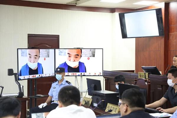 岚山欧宝体育登陆首页利用互联网远程提讯模式成功审理27人恶势力犯罪集团案