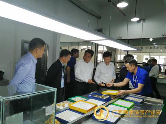 提升市场监管服务质量,何朝建调研广西黄金珠宝产业园