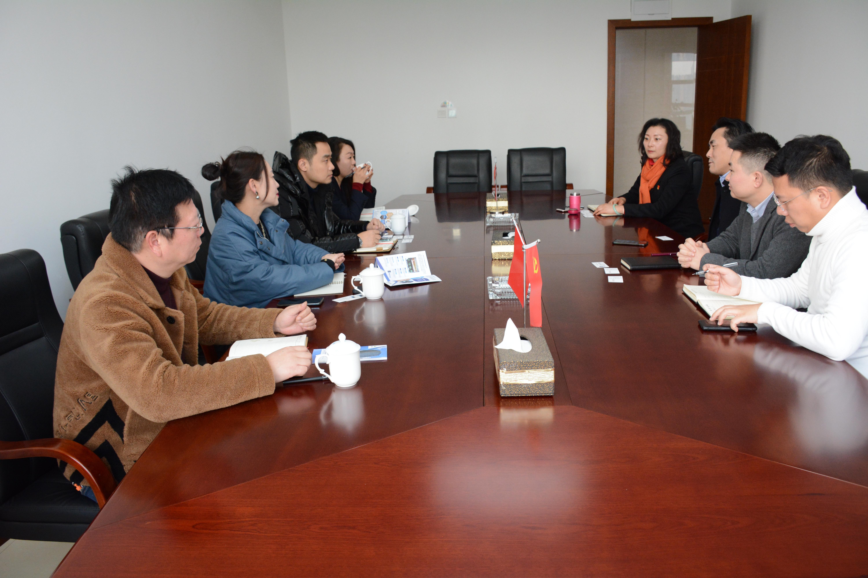 农信集团和富滇银行重庆分行开展合作交流